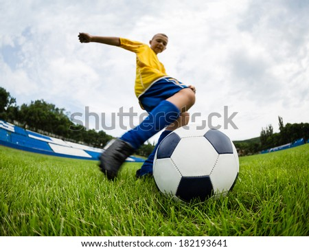 Excited boy football player after goal scored. Natural field. - stock photo