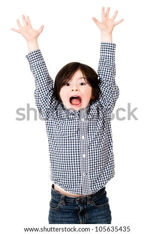 Excited boy with arms up - isolated over a white background