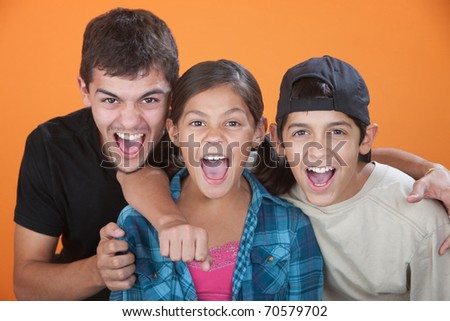 Excited brothers with their equally thrilled sister - stock photo