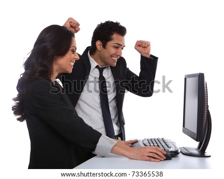 Excited Business couple looking at the desktop computer - stock photo