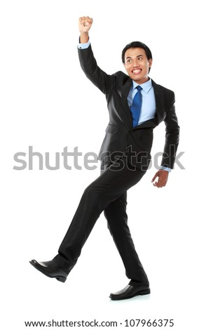 Excited business man celebrating success isolated on white background - stock photo