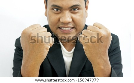 Excited business man celebrating success isolated on white background (focused at hand) - stock photo