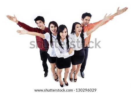 Excited business people raising their hands to form V letter on white background