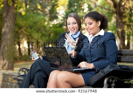 excited business people talking about job - stock photo