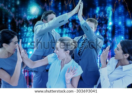 Excited business team cheering against stocks and shares - stock photo