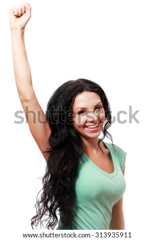 Excited business woman celebrating a triumph raise her hand up as she hold something in it - stock photo