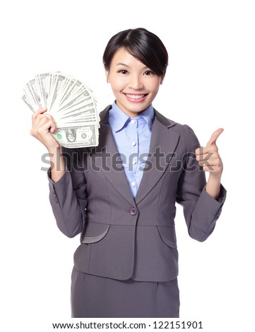 Excited business woman with handful of money giving thumbs up isolated on white background, asian beauty model - stock photo