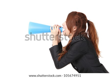 excited business woman yelling through megaphone to empty copy space isolated on white background, model is a asian woman