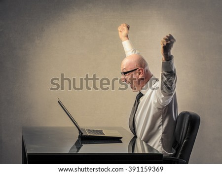 Excited businessman - stock photo