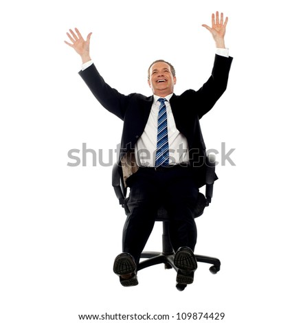 Excited businessman celebrating his success. Arms raised in air. - stock photo