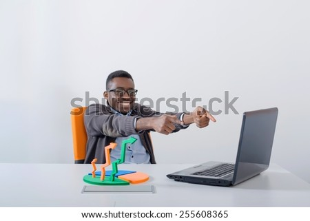 Excited businessman in an office