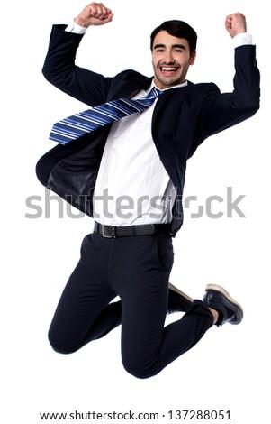 Excited businessman on knees, studio shot. - stock photo