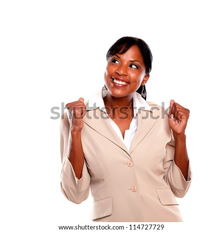 Excited businesswoman celebrating against white background - stock photo