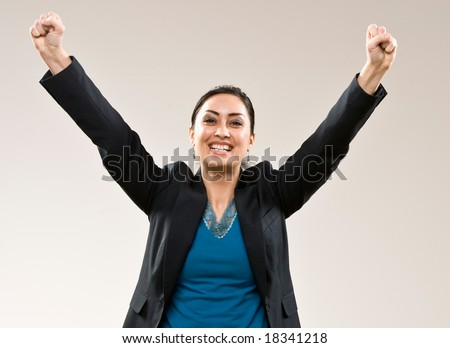 Excited businesswoman cheering and celebrating her success - stock photo