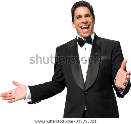 Excited Caucasian man with short black hair in a tuxedo talking with hands - Isolated - stock photo