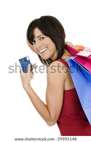 Excited Caucasian woman holding shopping bags and a credit card smiling on white background - stock photo