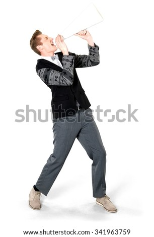 Excited Caucasian young man with short light blond hair in evening outfit using megaphone - Isolated