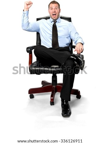 Excited Caucasian young man with short medium brown hair in business formal outfit celebrating - Isolated