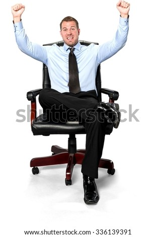 Excited Caucasian young man with short medium brown hair in business formal outfit celebrating with arms open - Isolated