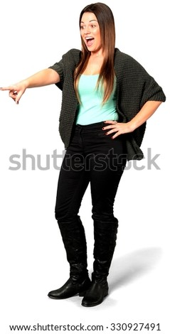 Excited Caucasian young woman with long medium brown hair in casual outfit with hands on hips - Isolated