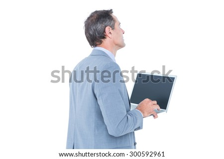 excited cheering businessman sitting using his laptop against a white screen - stock photo