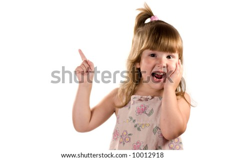 Excited child looking at you pointing up with laugh isolated on white - stock photo