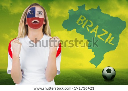 Excited chile fan in face paint cheering against football pitch with brazil outline and text - stock photo