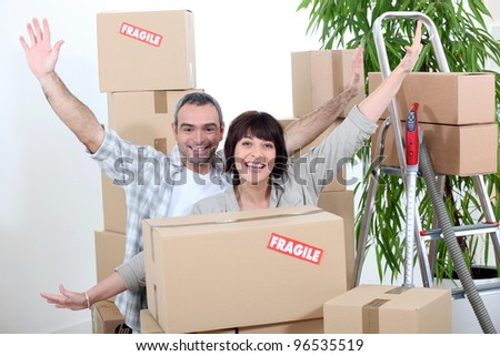Excited couple on moving day - stock photo