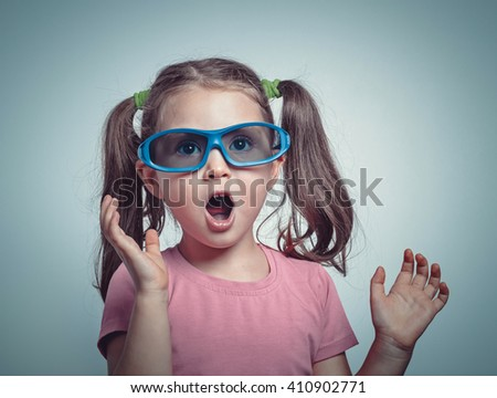 excited cute little girl with 3d glasses watching 3d movie - stock photo