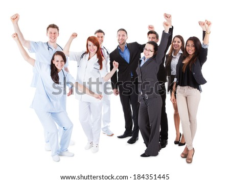 Excited doctors and managers raising arms. Isolated on white - stock photo