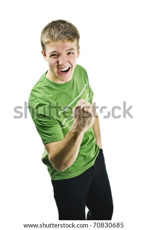 Excited energetic young man gesturing success isolated on white background - stock photo