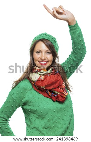 Excited exuberant pretty young woman cheering and smiling and raising her hands in the air with a joyful expression, isolated on white