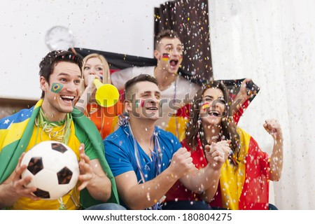 Excited fans of soccer celebrating winning match - stock photo