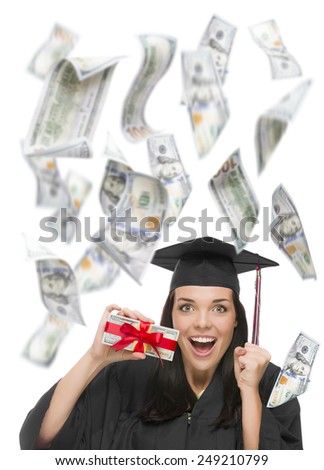 Excited Female Graduate in Cap and Gown Holding Stack of $100 Bills with Many Falling Around Her on White. - stock photo