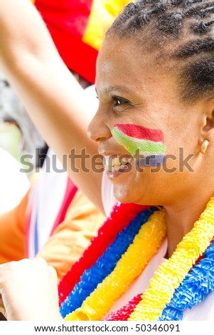 excited female sports fan watching a game - stock photo