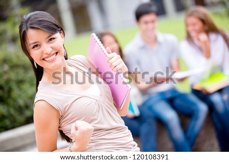 Excited female student celebrating an achievement looking happy - stock photo