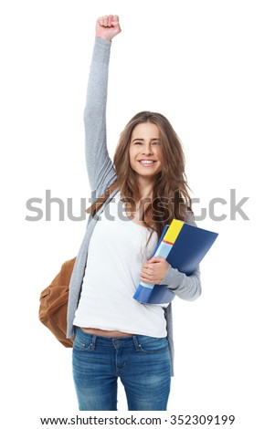 Excited female student raising hand her hand isolated on white background. - stock photo