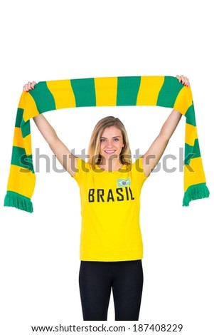 Excited football fan in brasil tshirt on white background - stock photo