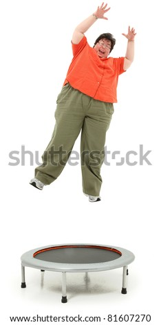 Excited forties obese woman jumping on trampoline over white background.