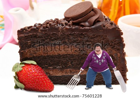 Excited forty-five year old caucasian woman with fork and knife standing on huge plate of dark and Milk chocolate cake with strawberry.