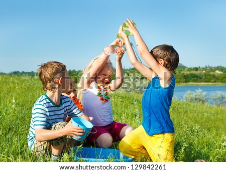 Excited friends pouring water on each other - stock photo