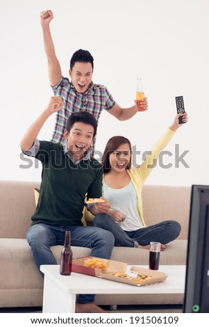 Excited friends supporting their favorite team - stock photo