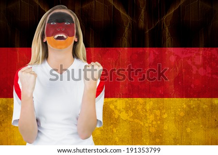 Excited german fan in face paint cheering against germany flag in grunge effect - stock photo