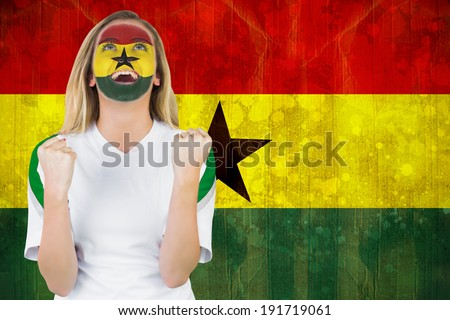 Excited ghana fan in face paint cheering against ghana flag in grunge effect - stock photo