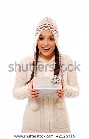 Excited girl holding gift on white background - stock photo