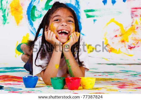 Excited girl painting - stock photo