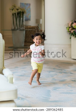 Excited girl playing at home - stock photo