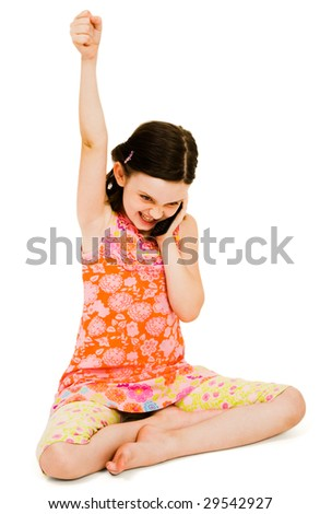 Excited girl talking on a mobile phone isolated over white - stock photo