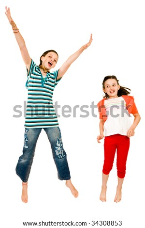 Excited girls jumping and smiling isolated over white - stock photo
