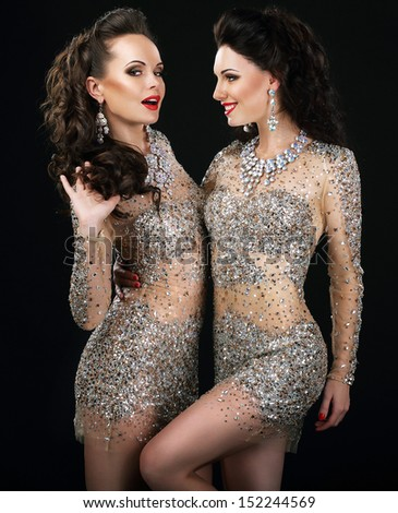 Excited Glamorous Couple in Platinum Dresses Talking - stock photo